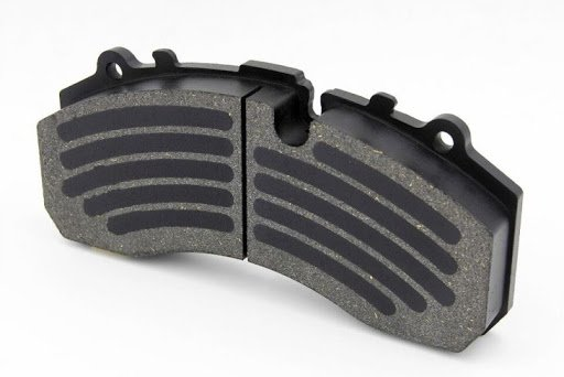 CV brake pad with bedding in coating for trucks and trailers